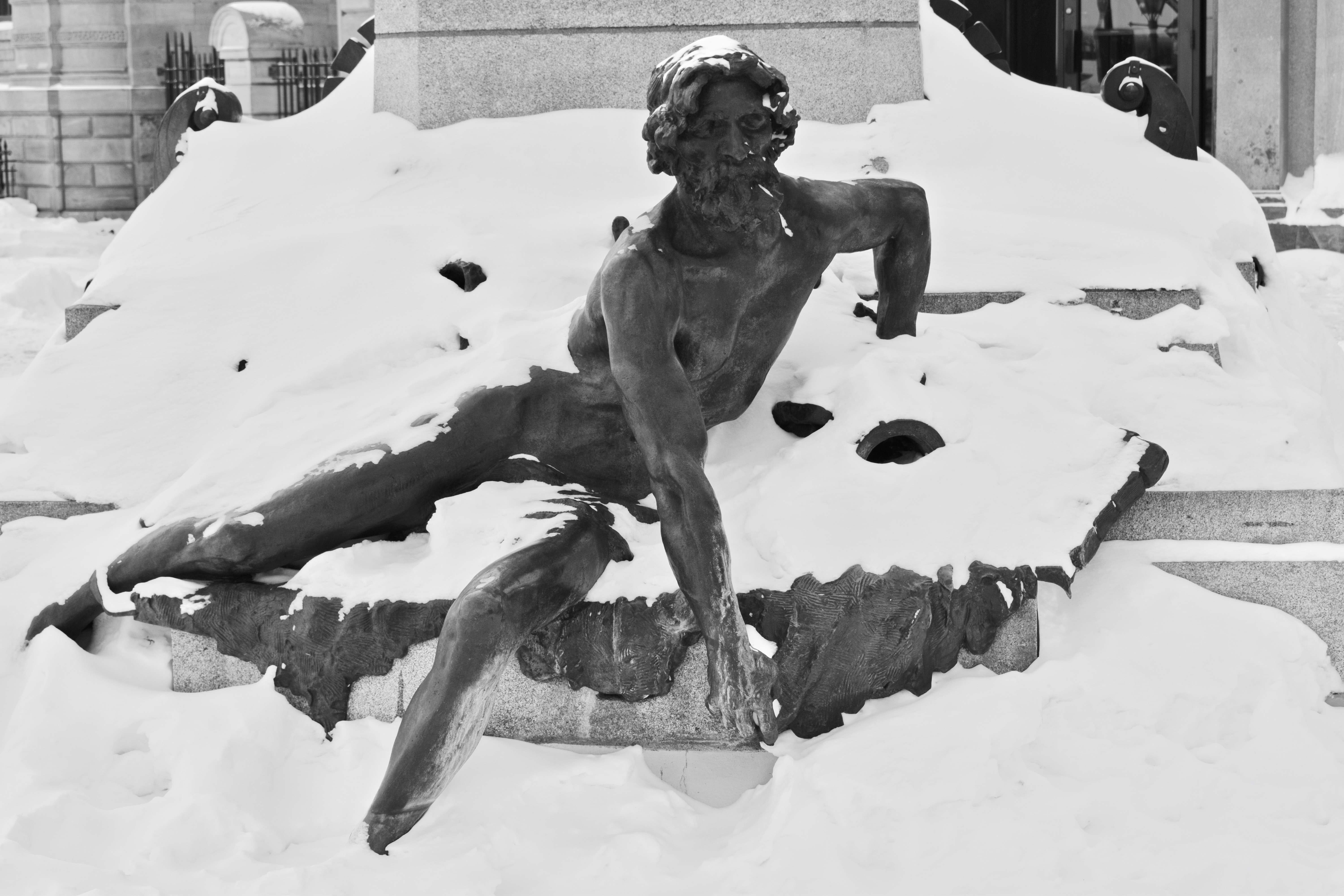 Sculpture in Old Montreal covered in snow. It's the weekend number 32